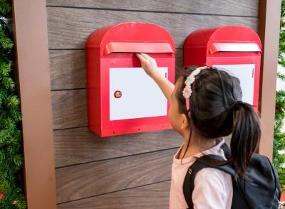 child posting a letter